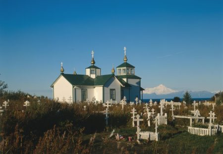 Orthodox Church of the Transfiguration, Ninilchik, Kenai Peninsula, Alaska.  In the distance is Redoubt Volcano on the other side of Cook Inlet. Library of Congress, Prints & Photographs Division, AK,9-NINI,1-14.